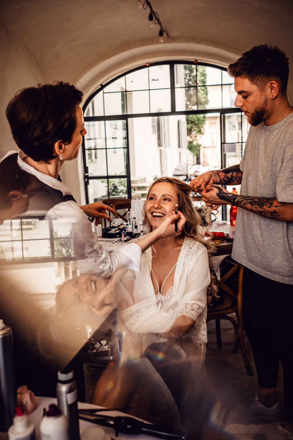Getting the hair and makeup done is a fairly elaborate process, so you should wear something comfortable like a super-smooth silk robe.