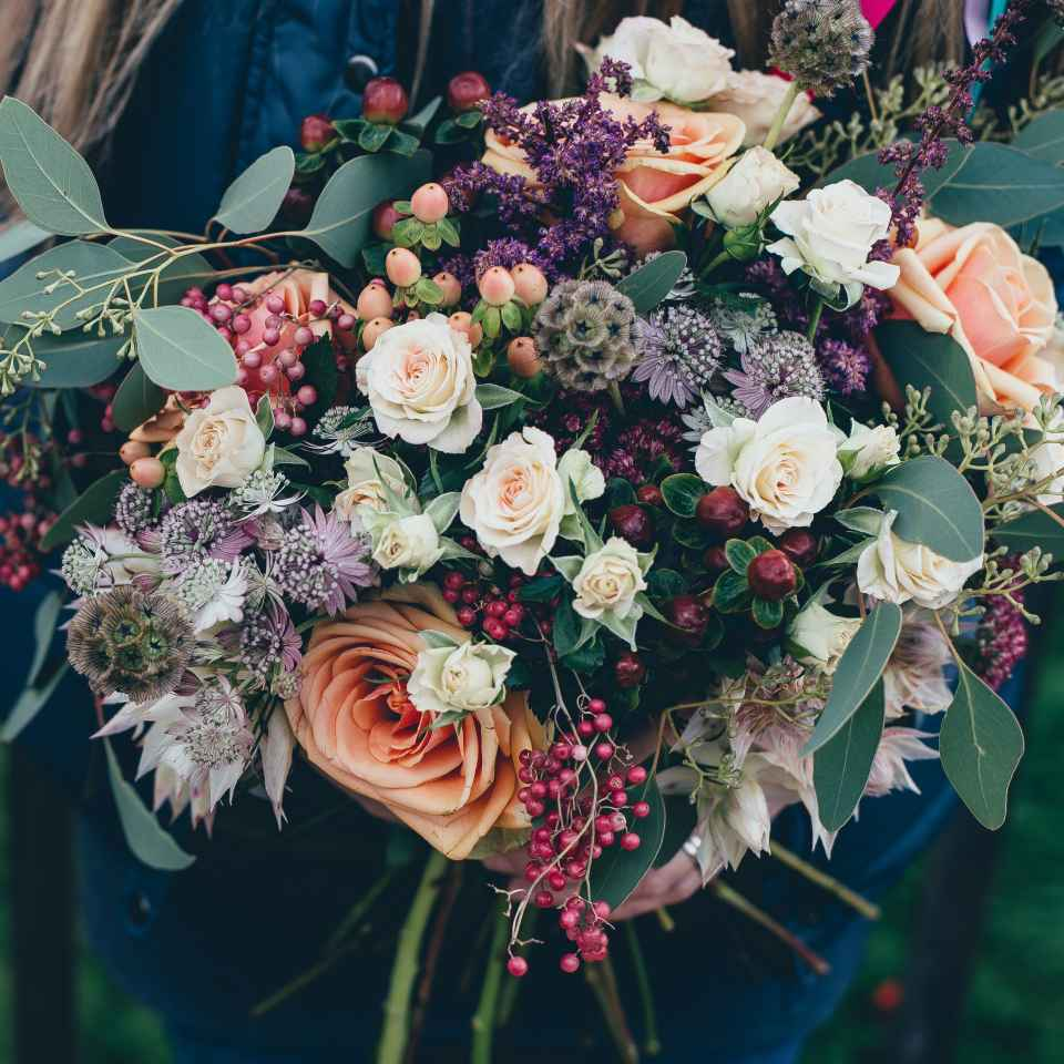Traditionally, the bride's family is supposed to pay for flowers at a wedding