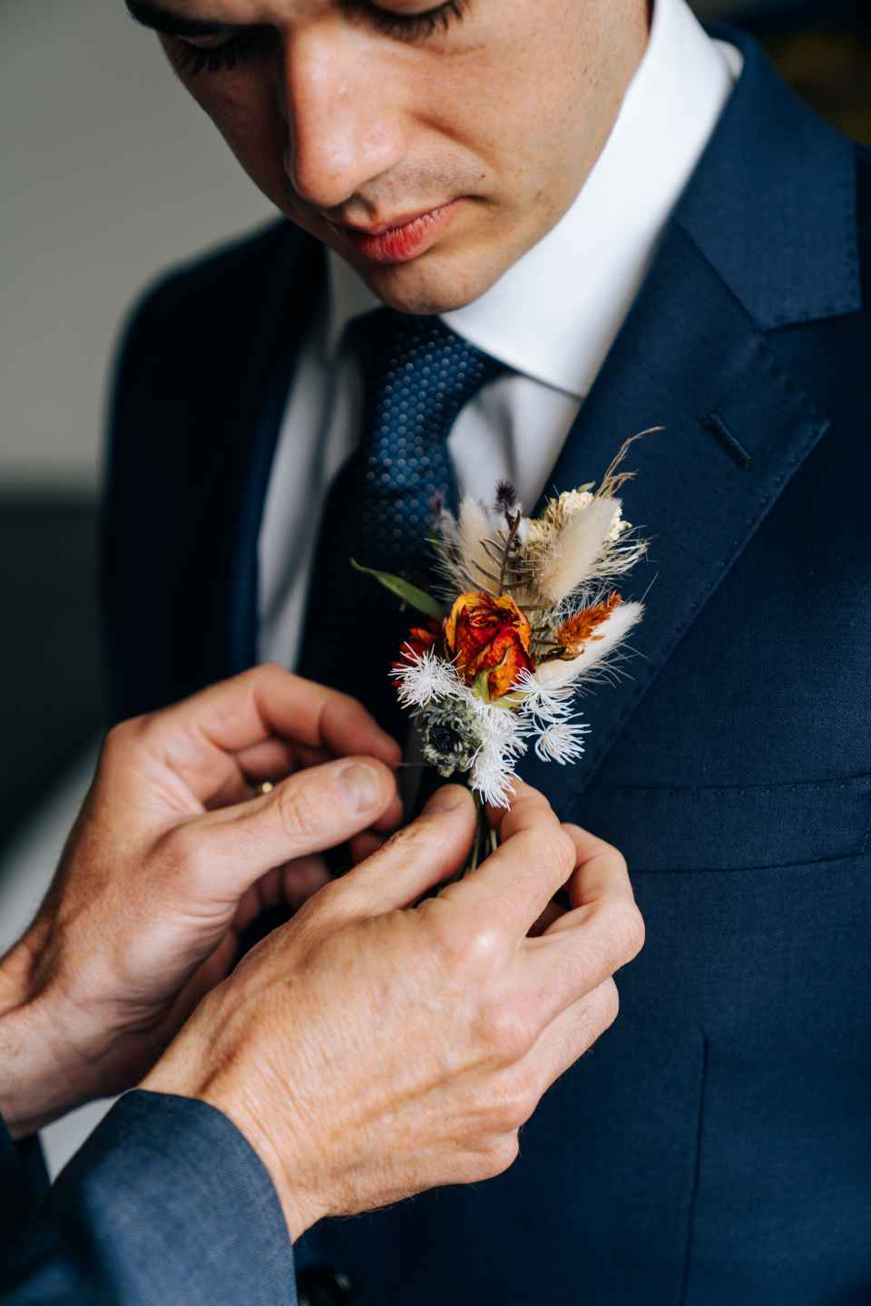 The groom's family pays for flowers that are used in the bridal bouquet, the groom's mother's and grandmother's mini bouquets or corsages