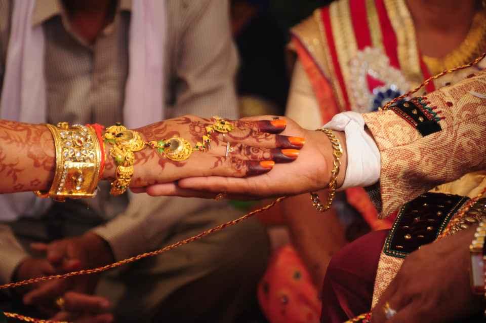 Under a wedding mandap, the main wedding ritual begins